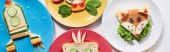 Fotografia top view of plates with fancy animals and rocket made of food for childrens breakfast on white background, panoramic shot