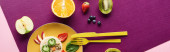 Photo top view of plate with fancy cow made of food near fruits on purple background, panoramic shot