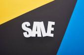 felső nézet eladó felirat kék, sárga és fekete háttér
