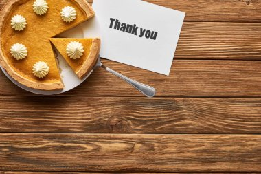 Top view of tasty pumpkin pie and thank you card on wooden rustic table stock vector