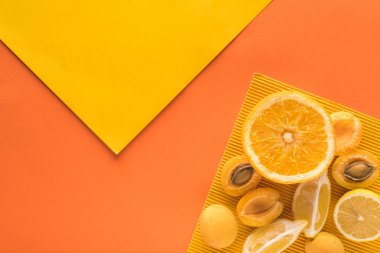 Top view of yellow fruits on yellow and orange background with copy space stock vector