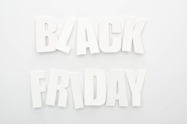 Top view of black Friday lettering on white background stock vector