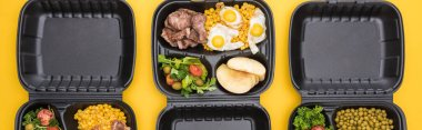panoramic shot of eco packages with vegetables, apples, meat, fried eggs and salads isolated on yellow