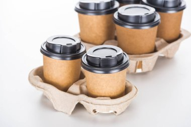 paper cups with coffee in cardboard tray on white background