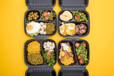 top view of eco packages with apples, vegetables, meat, fried eggs and salads isolated on yellow