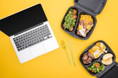 Top view of laptop, eco packages with apples, vegetables, meat, fried eggs and salads isolated on yellow stock vector