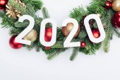 top view of 2020 numbers on Christmas tree wreath on white background
