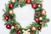 top view of 2020 numbers in Christmas tree wreath on white background