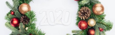 Top view of 2020 numbers in Christmas tree wreath on white background, panoramic shot stock vector