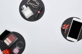 top view of gadget, gift boxes, perfume, bracelets, decorative cosmetics