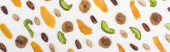 Fotografie top view of fresh assorted nuts, dried fruits and candied fruit isolated on white, panoramic shot