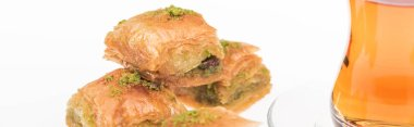 delicious turkish baklava and tea isolated on white, panoramic shot