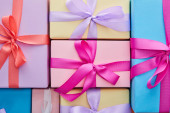 Fotografie flat lay with multicolored gift boxes with ribbons and bows
