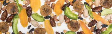 top view of Turkish assorted nuts, dried fruits and candied fruit isolated on white, panoramic shot