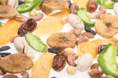 close up view of Turkish assorted nuts, dried fruits and candied fruit isolated on white