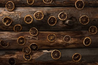 Top view of dried citrus slices on wooden background stock vector
