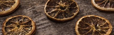 Dried citrus slices on wooden brown surface, panoramic shot stock vector