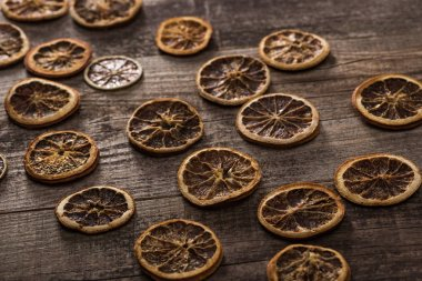 Dried citrus slices on wooden brown surface stock vector