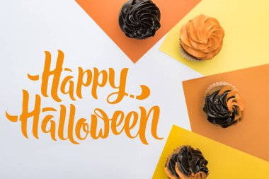 top view of delicious Halloween cupcakes on yellow, orange and white background  with happy Halloween illustration