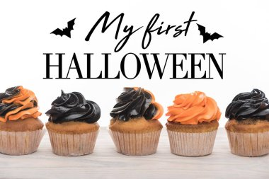 delicious Halloween orange and black cupcakes isolated on white with me first Halloween illustration