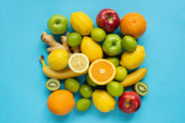Fotografie top view of ripe whole fruits on blue background