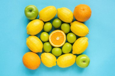 Top view of fresh fruits on blue background stock vector
