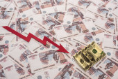 KYIV, UKRAINE - MARCH 25, 2020: top view of crisis graph near rubles and dollar banknote