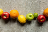 top view of tasty colorful fruits on grey concrete surface