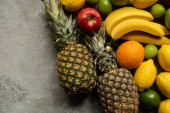 top view of colorful fresh fruits on grey concrete surface