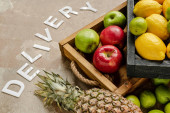 ripe fruits in wooden boxes near word delivery on weathered surface