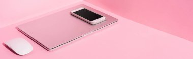 Laptop, smartphone and computer mouse on pink background, panoramic shot stock vector