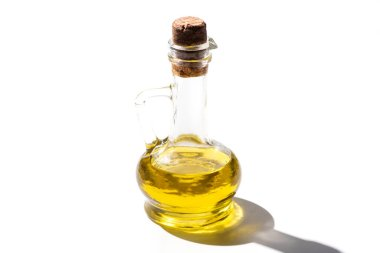 Olive oil in glass jar with cork on white background stock vector