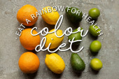 Fotografie flat lay with colorful oranges, avocado, limes and lemons on grey concrete surface, color diet illustration