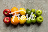 top view of tasty colorful fruits on grey concrete surface, fresh illustration