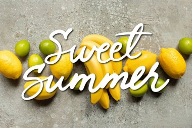 Top view of colorful bananas, limes and lemons on grey concrete surface, sweet summer illustration stock vector