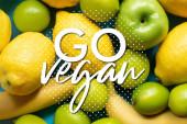 top view of yellow lemons, bananas, green apples and limes, go vegan illustration