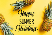 top view of fresh tasty pineapples on yellow background with happy summer holidays illustration