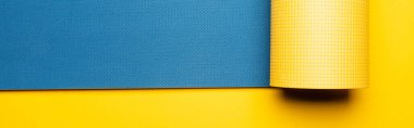 Top view of blue fitness mat on yellow background, panoramic shot stock vector