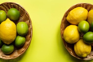 Top view of ripe limes and lemons in wicker baskets on colorful background stock vector