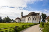 Fotografie The Pilgrimage Church of Wies (Wieskirche), an oval rococo church located in the foothills of the Alps, Bavaria, Germany. A World Heritage Site since 1983