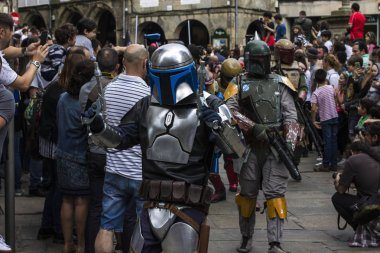 People disguised in Star Wars costumes for the III Imperial Stormtroopers parade 2017 in the Old City of Santiago de Compostela, Spain