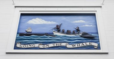 Nantucket, Massachusetts. Painted mural relief representing a hunting of whales scene in the facade of the Nantucket Whaling Museum
