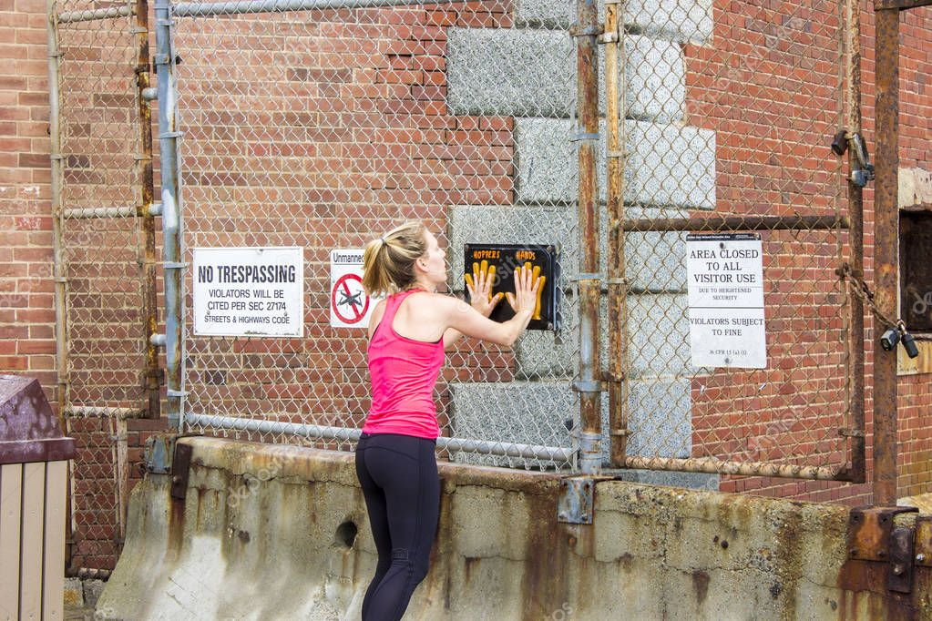 Female runner doing a high-five with the Hopper's Hands sign in Fort Point, San Francisco, California