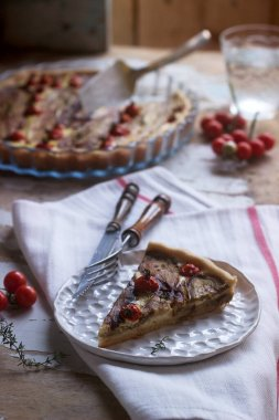Pie stuffed with vegetables, cottage cheese and cream on a wooden background. Rustic style.