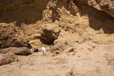 Cala Tarida, Ibiza, Balearic Islands - August 28, 2014 : Tourists sunbathing in Cala Tarida