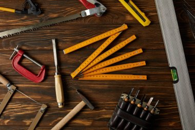 top view of different tools on brown wooden table