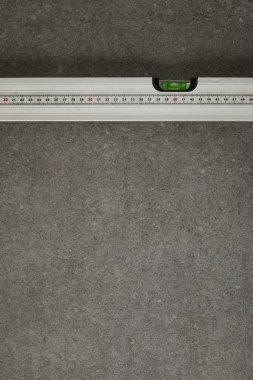 view from above of spirit level on gray surface