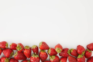 top view of arranged fresh strawberries isolated on white