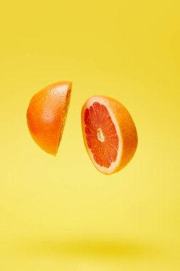 close up view of cut grapefruit isolated on yellow