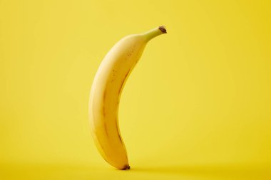 close up view of fresh banana isolated on yellow